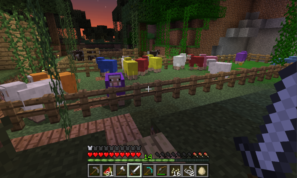 Capture d'écran de mon élevage de moutons colorés dans le jeu Minecraft.